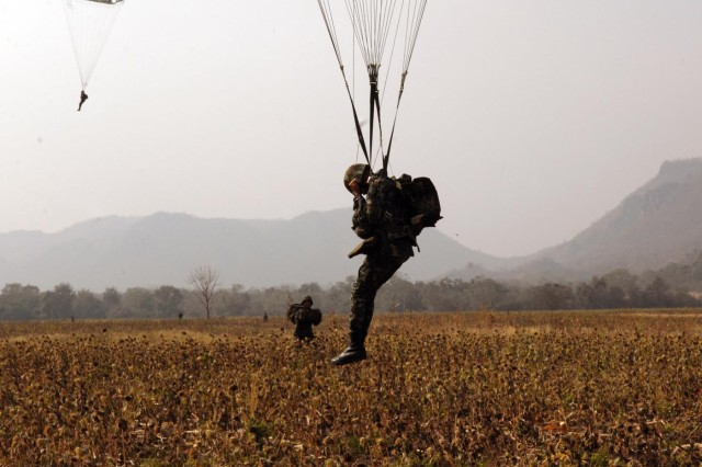 TADIA DROP ZONE, Thailand - A Thai soldier assesses his drift direction as he lands during a U.S.-Thai airborne skill badge exchange jump with U.S. Army Alaska's 3rd Battalion, 509th Parachute Infantry Regiment Feb. 9 at Tadia Drop Zone, Thailand, during exercise Cobra Gold 2011.