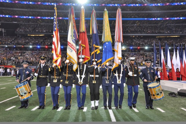 Members of the Continental Color Guard, Honor Guard Company, 3rd U.S. Infantry Regiment (The Old Guard), perform during Super Bowl XLV Sunday, February 6 at Cowboys Stadium in Arlington, Texas, as part of the Armed Forces Color Guard. Continental Color Guard from left to right: Spc. Adam King, Lead Guard; Sgt. 1st Class Andrew Gregory, National Flag Bearer; and Sgt. Nicholas Bogert, Army Flag Bearer. The Continental Color Guard displays the Colors in numerous parades and ceremonies throughout the year. The team has performed in such notable events as presidential inaugurals, and the Olympics.