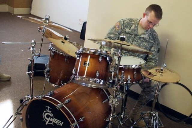 Staff Sgt. Chad J. Alward plays the drums prior to a recent military performance. Alward is assigned to the 81st RSC's 100th Army Reserve Band, based out of Fort Knox, Ky. Alward received the inaugural 2010 Col. Finley Hamilton Outstanding Military Musician Award during a ceremony Feb. 13, at the command headquarters' building.