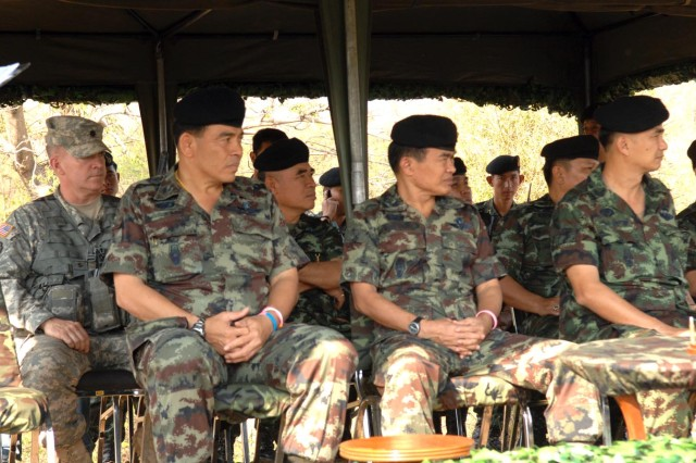 Royal Thai Army Maj. Gen. Phi Boon Khoomchaya, deputy commander of the 1st Army Area Thailand (front left), and Maj. Gen. Kampanart Ruthdit, commander of the Thai Army's 1st Division (front center), sit with 3rd Battalion, 509th Parachute Infantry Regiment Commander Lt. Col. Shawn Daniel and listen to a briefing on the day's U.S.-Thai live-fire training Feb. 11, at Pulon Range, Thailand, during Cobra Gold 2011.