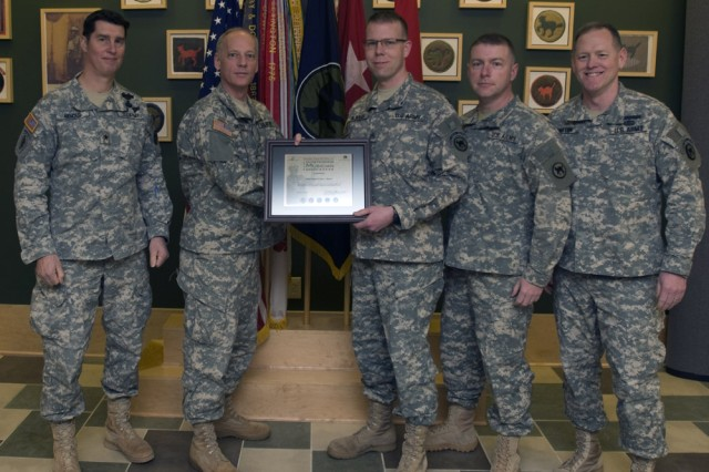 Brig. Gen. Mark Arnold, deputy commander for the 81st Regional Support Command, Maj. Gen. Bill Gerety, 81st RSC commander, Staff Sgt. Chad J. Alward, Command Sgt. Maj. James Wills, 81st RSC's senior enlisted Soldier, Chief Warrant Officer Lawrence Barton, the 100th Army Reserve Band commander, were present at the award ceremony for Alward. Alward received the inaugural 2010 Col. Finley Hamilton Outstanding Military Musician Award during a ceremony Feb. 13, at the command headquarters' building.
