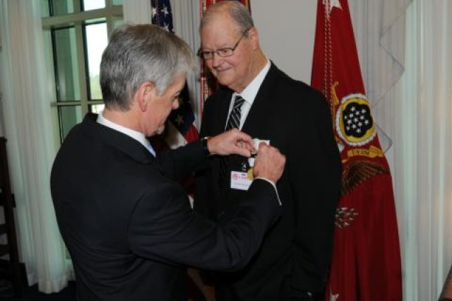 The Honorable John McHugh, Secretary of the Army, congratulates former Congressman Ike Skelton during a ceremony Feb. 14, 2011 at the Pentagon.