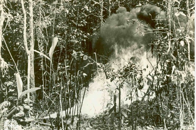 A portable flamethrower, used on Munda and operated by Major James E. Larkin, Chemical Warfare Officer, 37th Infantry Division, on August 7, 1943, demonstrates the brutal environment that American Soldiers experienced in the Pacific Theater.