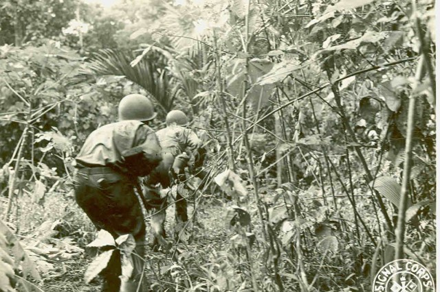 A combat patrol of the 43rd Infantry Division cautiously makes its way through the thick jungle of New Georgia on July 9, 1943.