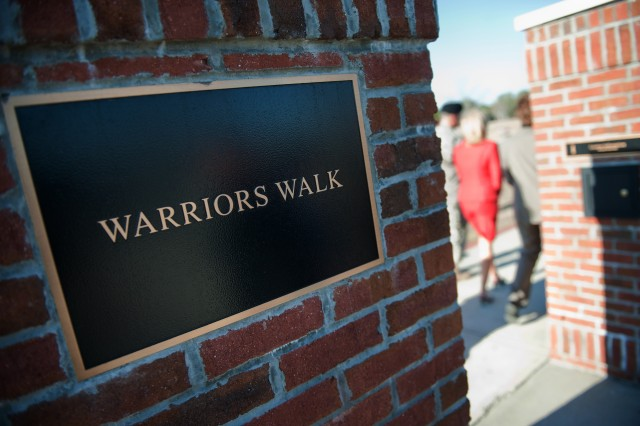 Dr. Jill Biden, wife of Vice President Joe Biden, visits the Warriors Walk at Ft. Stewart, GA, Feb. 14, 2011. The Warriors Walk serves as a living monument to 3rd Infantry Division Soldiers who have made the ultimate sacrifice in Operations Iraqi Freedom and Enduring Freedom.