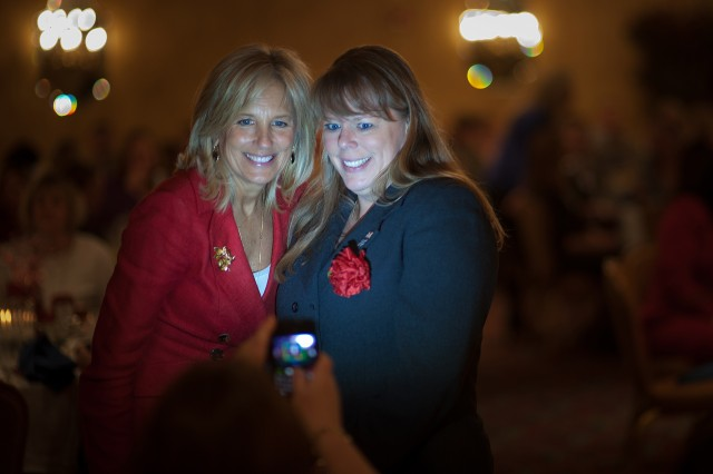 Dr. Jill Biden, wife of Vice President Joe Biden, takes a picture with an Army wife during her visit at Fort Stewart, Georgia, Feb. 14, 2011.  The visit is part of the administration's ongoing work to raise awareness and show appreciation for service members and their families.