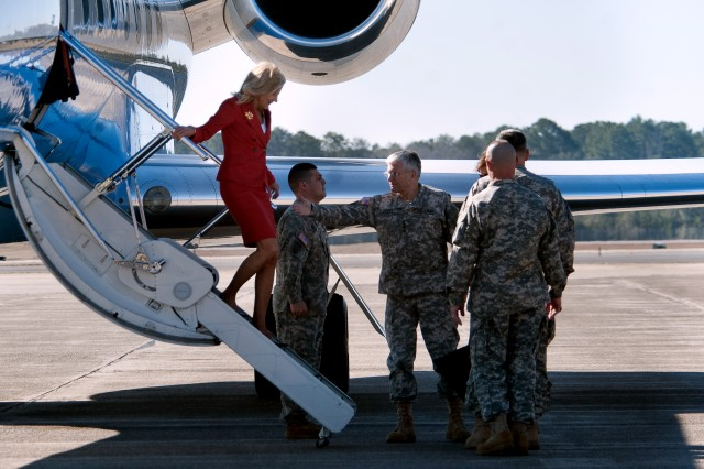 Chief of Staff of the Army, Gen. George W. Casey Jr., helps Dr. Jill Biden, wife of Vice President Joe Biden, off a plane as they arrive at Hunter Army Airfield, Georgia, Feb. 14, 2011.  Dr. Biden's visit is part of the administration's ongoing work to raise awareness and show appreciation for service members and their families.