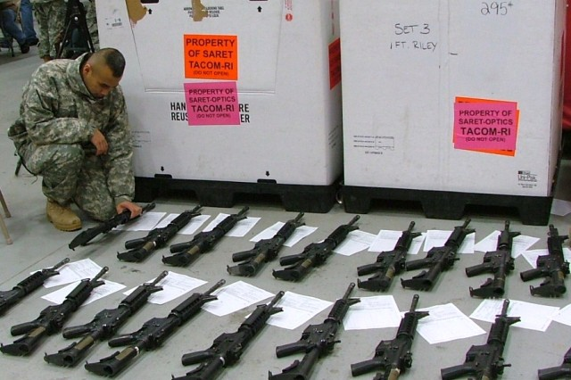 A Soldier from the 2nd Brigade Combat Team, 10th Mountain Division, checks the serial numbers of M4 carbines and corresponding paperwork before they go through Reset by the Small Arms Readiness Evaluation Team at Fort Drum, N.Y.
