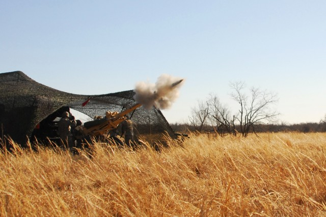 An M119 howitzer from 2nd battalion, 32nd field artillery regiment fires a 105mm high explosive round during a live fire exercise at Fort Sill, Oklahoma on January 29th, 2011 in support of Operation Diamond Freeze CALFEX. ""