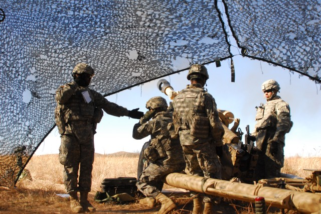 An M119 Howitzer gun chief instructs his crew to fire their weapon during a live fire exercise in support of Operation Diamond Freeze CALFEX at Fort Sill, Oklahoma on January 29th, 2011.""