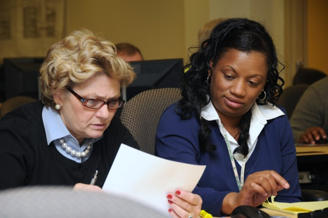 Nancy Ferguson (left) and Linda Love team up on a study exercise given during a space management class as part of the GFEBS training held at the 81st RSC, Feb. 15.  The 81st RSC will begin using GFEBS resource management applications April 1.