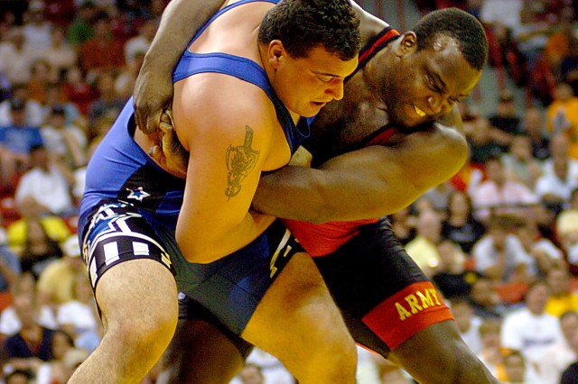 U.S. Army World Class Athlete Program teammates Staff Sgt. Dremiel Byers (right) and Spc. Timothy Taylor square off in the Greco-Roman 264.5-pound finals of the 2008 U.S. Olympic Team Trials for Wrestling at the Thomas & Mack Center in Las Vegas. Byers won the best-of-three series and will wrestle for Team USA in the Olympic Games on Aug. 14 in Beijing. Taylor will accompany Byers to China and serve as his training partner.