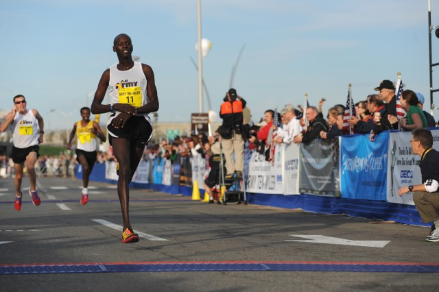 U.S. Army World Class Athlete Program Spc. Robert Cheseret, seen here finishing the 2010 Army Ten-Miler at the Pentagon, won the men's 12-kilometer race at the 2011 Armed Forces Cross Country Championships with a time of 36 minutes, 37 seconds on Feb. 5, in San Diego.