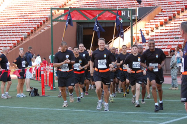 "HONOLULU - Lt. Col. Colin Tuley (center), battalion commander, leads Soldiers of the 2nd Battalion, 35th Infantry Regiment, ""Cacti,"" 3rd Brigade Combat Team, 25th Infantry Division, as they finish the 2010 Great Aloha Run at the Aloha Stadium in Honolulu, Feb. 15."