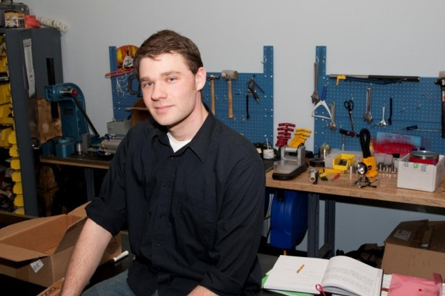 "Army engineer Adam Druga with the Armamament Research, Development and Engineering Center (ARDEC), pursues his innovation goals at a workshop on Picatinny Arsenal. Druga is part of the ""Innovative Developments Everyday at ARDEC"" program, or IDEA, to help ARDEC remain competitive with the best innovating labs in government and industry."