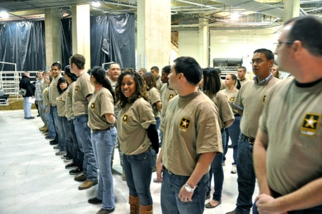 The Army's newest recruits wait to march in formation onto the floor of the arena.