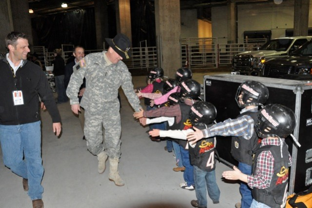 Lt. Gen Rick Lynch greets the youngest cowboys of the rodeo: the mutton-busters.