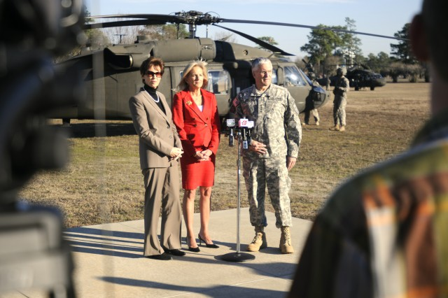Chief of Staff of the Army Gen. George Casey Jr., Jill Biden (center) and Sheila Casey (left) speak with reporters during a press conference after their one-day visit with 3rd Infantry Division families and Soldiers Feb. 14, at Fort Stewart, Ga.