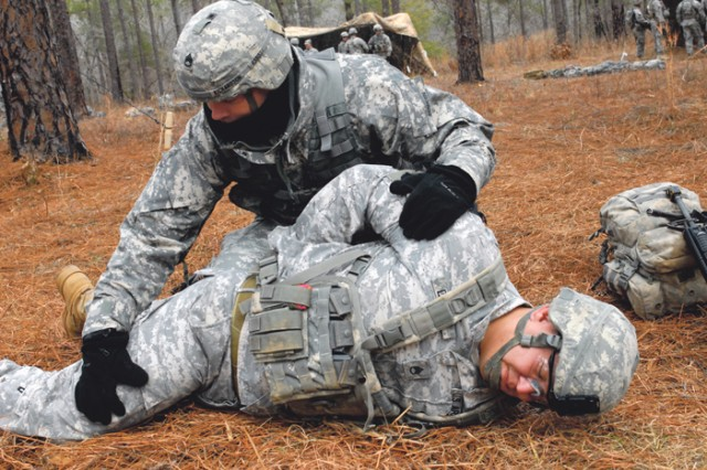 """Staff Sgt. Bret Richardson searches Staff Sgt. Michael Dailey for weapons, documents and contraband Wednesday during an """"entering prisoner of war"""" scenario on the urban lane."""