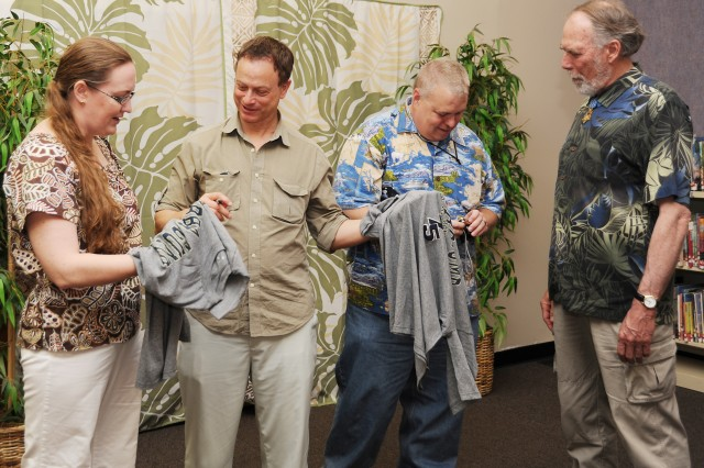 "Gary Sinse, (second from left) actor, musician and leader of the Lt. Dan Band, signs Bubba Gump T-shirts for Lt. Col. Laura Bozeman, speechwriter for the USARPAC commander, Lt. Gen. Benjamin R. Mixon, and her husband Mike, a Wounded Warrior and management analyst with the Logistics Directorate at U.S. Army Garrison Hawaii. Sinise was accompanied by Medal of Honor recipient retired Army Maj. Drew Dix (right). Mike Bozeman is a member of the Wounded Warrior Transition Battalion at Tripler Army Medical Center in Honolulu. Sinise's band and organization is a cover band founded by Kimo Williams and Sinise. It is named after the character Lieutenant Dan Taylor, whom Sinise portrayed in the film ""Forrest Gump.""  The Lt. Dan Band has grown from the occasional jam session and Chicago-area gigs to performing for charities and non-profit organizations including the USO and Operation Iraqi Children, the latter of which was co-founded by Sinise in March 2004.They frequently visit military bases in the United States and abroad. They performed at Schofield Barracks Feb. 12. (U.S. Army photo by Betsy Weiner)"