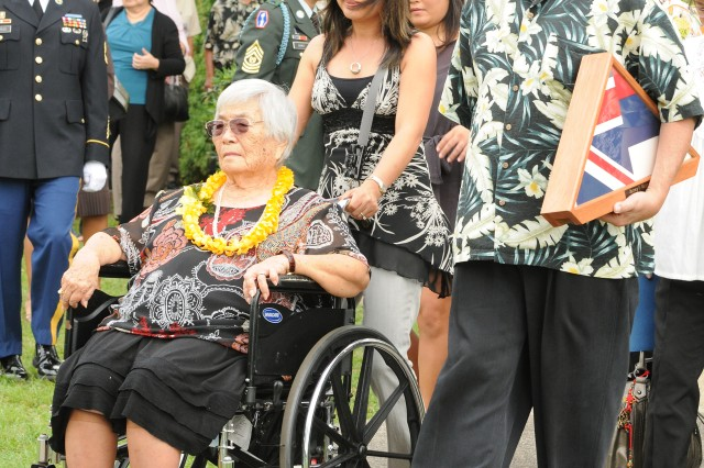 Esther Hajiro, wife of Pvt. Barney Hajiro, Medal of Honor recipient who died Jan. 21, and her son Dean leave the burial service for Hajiro Feb. 14 at the National Memorial Cemetery of the Pacific, Honolulu. At the time of his death, Hajiro was the oldest living Medal of Honor recipient.