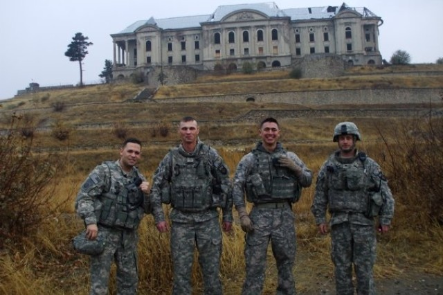 Sgt. Nelson Villanueva Jr., far left, poses in front of the Queen's Palace in Kabul, Afghanistan, in January 2010 with other members of the Personal Security Detail for the team's commanding general and command sergeant major. Villanueva join the U.S. Army Space and Missile Defense Command/Army Forces Strategic Command Feb. 8 as Command Sgt. Maj. Larry Turner's driver.