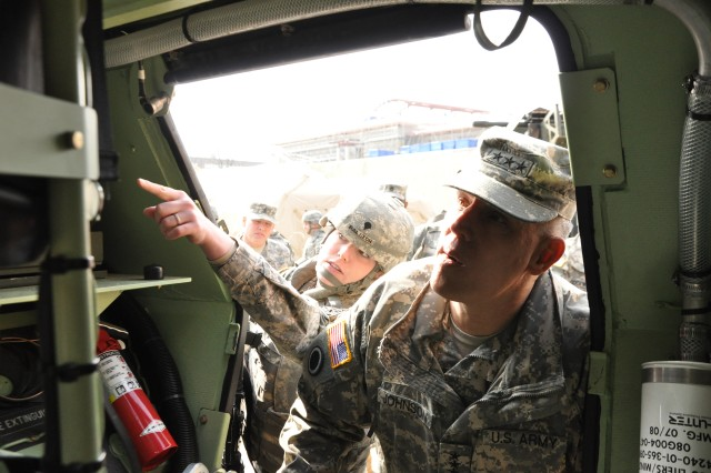 (from left to right) Spc. Casey Ralson, 188th Military Police Company, 94th Military Police Battalion, 501st Sustainment Brigade, briefs Lt. Gen. John D. Johnson, 8th Army commander at Camp Carroll, Republic of Korea Feb. 16, 2011.