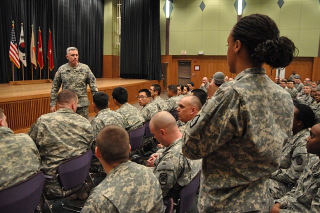 A member of the 19th Expeditionary Sustainment Command asks Lt. Gen. John D. Johnson, 8th Army commander, a question at Camp Carroll, Republic of Korea Feb. 16, 2011.