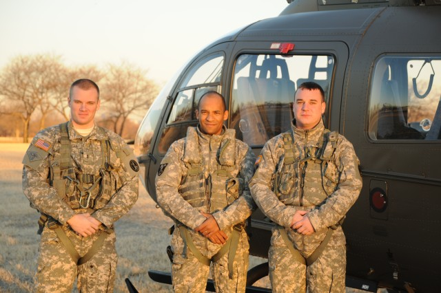 """Three Soldiers from Bravo Company (Black Sheep) 12th Aviation Battalion, stand next to their """"Lakota"""" UH - 72A helicopter after completing the first operational mission of the newly assigned Lakota to their unit.  (left) Co-pilot, Chief Warrant Officer Two Matthew Covell, Pilot-In-Command, Chief Warrant Officer Three Andre Kidd, and Crew Chief, Specialist Kyle Shields' mission brought Major General James L. Hodge, Commanding General U.S. US Army Combined Arms Support Command Sustainment Center of Excellence at Fort Lee, VA to Fort McNair, 7 a.m., 11 February 2011.  The UH - 72A twin engine helicopter is an essential enabler during contingency missions by providing enhanced defense support to civil authorities and as well as providing secure passenger transportation within the National Capital Region."""