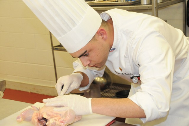 Spc. Matthew Hendrik, representing Team U.S. Army Europe, prepares a chicken for cooking during the 2010 Nutritional Hot Food Challenge.