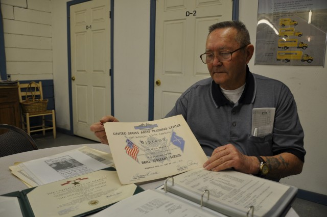 "Retired 1st Sgt. Norman ""Dale"" Abbott displays the diploma he received after graduating from Fort Jackson's Drill Sergeant School in 1965. The school, which was established in 1964, was the first Drill Sergeant School in the Army. The new Drill Sergeant School building will celebrate its opening in a ceremony Wednesday."