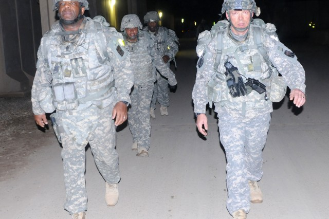 Command Sergeant Major Clifton Johnson, 3rd Sustainment Brigade, 103rd Sustainment Command (Expeditionary), Jason Runnels, 14th Movement Control Battalion, 103rd ESC,  lead the brigade on a five-mile Senior Leader ruck march Jan. 28 at Joint Base Balad, Iraq. This is the third time the brigade has hosted this event.