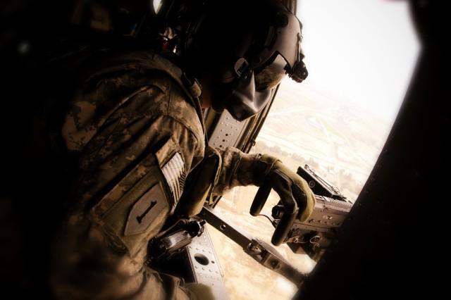 Army Black Hawk crew chief Spc. Christopher Wilmeth watches the Iraqi countryside Feb. 10, during a mission near Baghdad.
