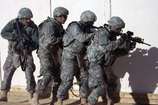 CAMP BUEHRING, Kuwait - Troopers from B Troop, 6th Squadron 9th Cavalry Regiment, 3rd Advise and Assist Brigade, 1st Cavalry Division prepare to enter a building as a part of their third day of training on tactical convoy operations.