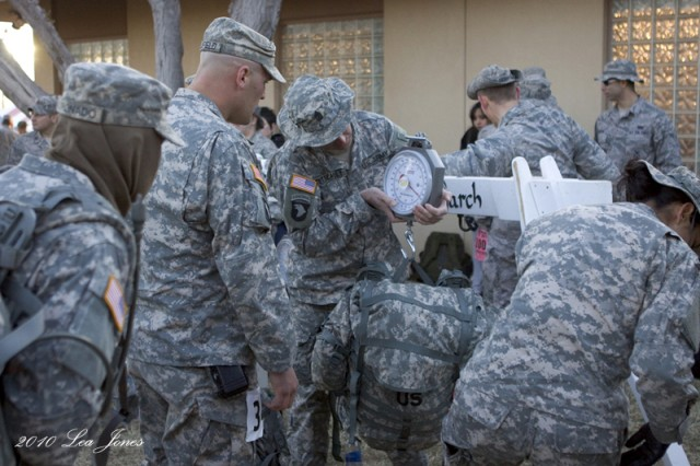 Participants in the heavy division weigh packs after the march.