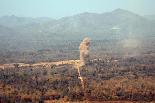 BAN DAN LAN HOI, Thailand - Explosions from U.S. and Thai weaponry tear through the empty valley of Ban Dan Lan Hoi during an assault on a fictional enemy in a final combined arms live fire exercise, or CALFEX, during Exercise Cobra Gold 2011.