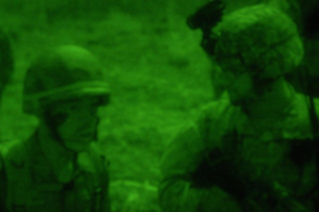 BAN DAN LAN HOI, Thailand - Thai and U.S. officers discuss plans and tactical options under cover of darkness during a training mission for Cobra Gold 2011.