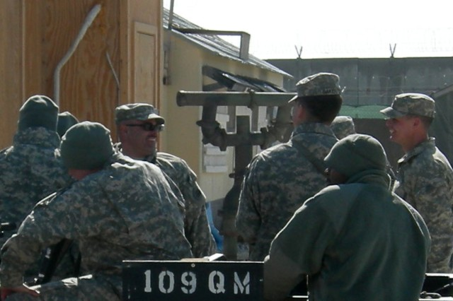 Soldiers of the 109th Quartermaster Company, 17th Combat Sustainment Support Battalion, 101st Sustainment Brigade, gather outside their headquarters and office buildings on Bagram Air Field, Afghanistan. Instead of conducting their MOS-based skills, the Soldiers are assigned convoy security duty here.