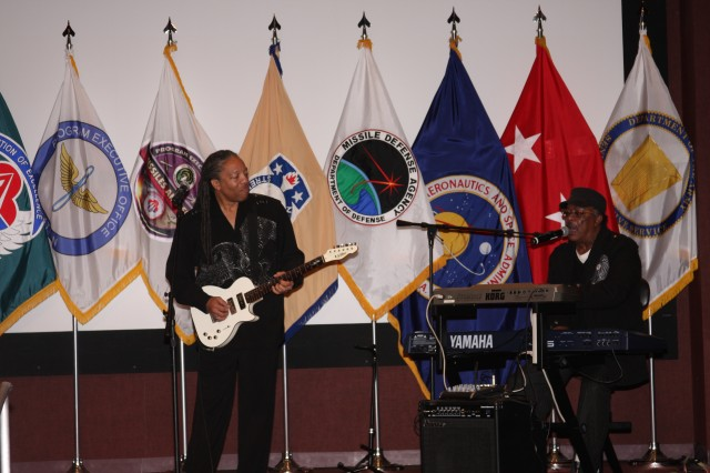 Keyboardist Mark Bynum and guitarist Tony Gentry, who most recently toured with the Soul, R&B and Funk band the Bar-Kays, play during Redstone Arsenal's Black History Month celebration on Wednesday.