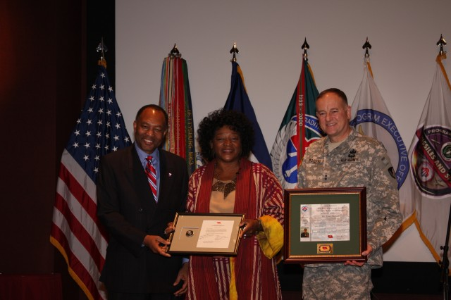 Robert Moore, left, U.S. Army Security Assistance Command deputy commanding general, and Maj. Gen. James E. Rogers, commanding general of U.S. Army Aviation and Missile Command, thank Dr. Tonea Stewart, actress and dean of the College of Visual and Performing Arts at Alabama State University, for speaking at Redstone Arsenal's Black History Month celebration on Wednesday.
