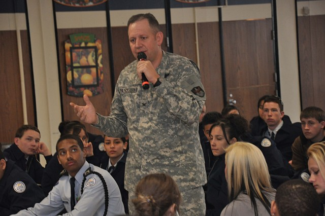 Col. Eric Henderson, 1st Space Brigade Commander, speaks to the JRTOC cadets at General William Mitchell High School about the importance of using caution on the internet. Henderson spoke to the crowd of nearly 300 about keeping their personal information safe on social media websites.