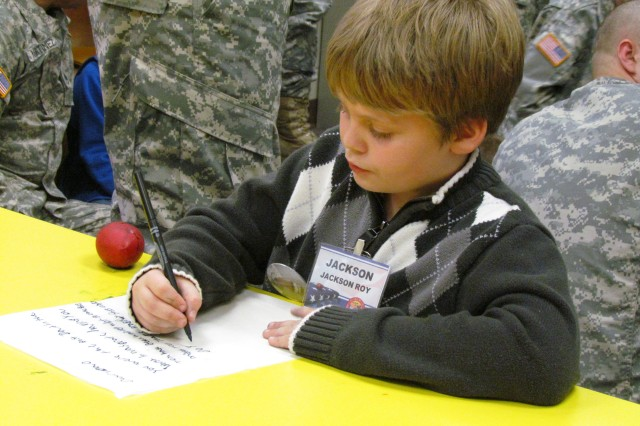 Survivor Jackson Roy writes a letter to his dad that will be attached to a balloon and released during the Balloon Lift-Off that culminated the Good Grief Camp for children and teens.