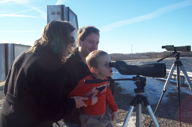Family viewing Bald Eagles and other birds from the Carlyle Lake Dam.