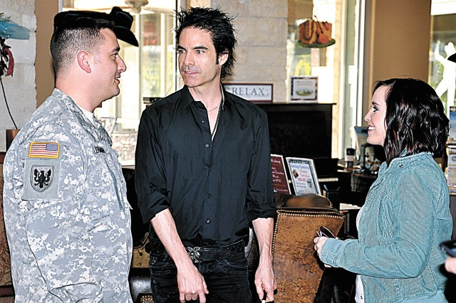 "Pat Monahan, lead singer for the band Train (center), takes time to talk with Sgt. Dallas German and his wife, Aprel, when he stopped by the Warrior and Family Support Center on Fort Sam Houston Feb. 11, a few hours before the band's performance at the AT&T Center as part of the San Antonio Stock Show and Rodeo. After getting a short tour of the facility, Monahan stayed to talk to numerous Soldiers and their Families, sign autographs and pose for photos. The band won a Grammy Award Feb. 13 for ""Best Pop Performance By A Duo or Group With Vocals"" for their international hit song, ""Hey, Soul Sister."""