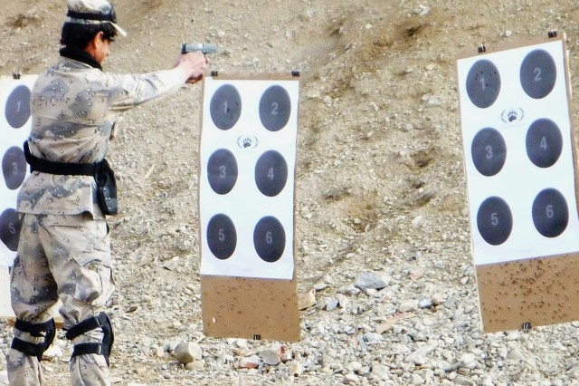 A recruit in the Afghan Border Police Basic Course fires a 9-mm pistol for familiarization on a range at Spin Boldak (Kodiak) training area whose targets go from 3 meters up to 15 meters.
