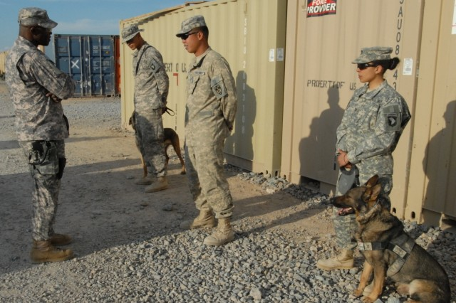 Command Sgt. Maj. Bernard McPherson, Program Executive Officer Soldier, talks with Military Working Dog handlers, Feb. 16 at Forward Operating Base Wilson, Afghanistan.