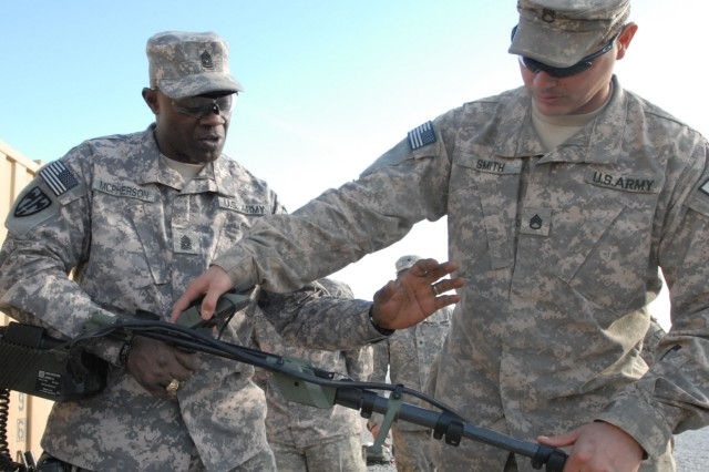 Staff Sgt. Patrick Smith, 595th Sapper Company, 2nd Engineers Battalion out of White Sands Missile Range, N.M., explains the capabilities of a mine detector to Command Sgt. Maj. Bernard McPherson, Program Executive Officer Soldier, Feb. 16 at Forward Operating Base Wilson, Afghanistan.