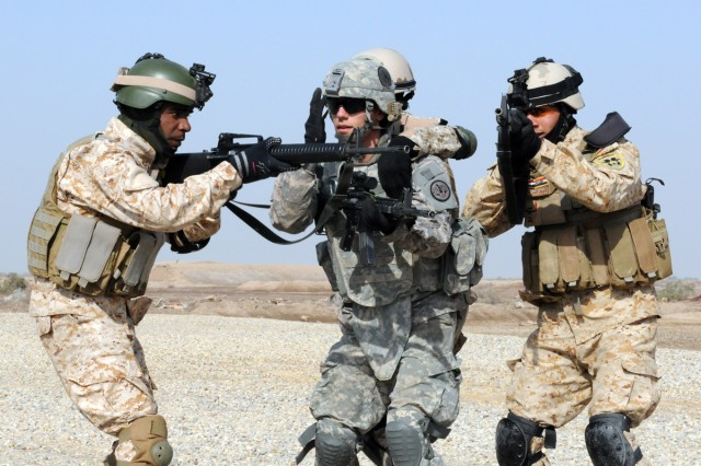 A Soldier from Battery L, 2nd Squadron, 3rd Armored Cavalry Regiment, leads Iraqi Army soldiers in a squad drill on Contingency Operating Base Delta, Iraq, Feb. 16, 2011.  Lion Battery is working with the IA on basic squad and platoon level exercises to improve their cohesion and readiness.