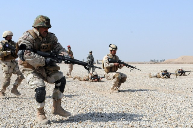 Iraqi Army soldiers attack an objective during bounding exercises, alongside Soldiers of Battery L, 2nd Squadron, 3rd Armored Cavalry Regiment, on Contingency Operating Base Delta, Iraq, Feb. 16, 2011.  IA soldiers conducted single-file, wedge, and stack drills in addition to bounding forward and rearward. Both local IA, and members of Lion battery, are scheduled to conduct an entire week of training on COB Delta.