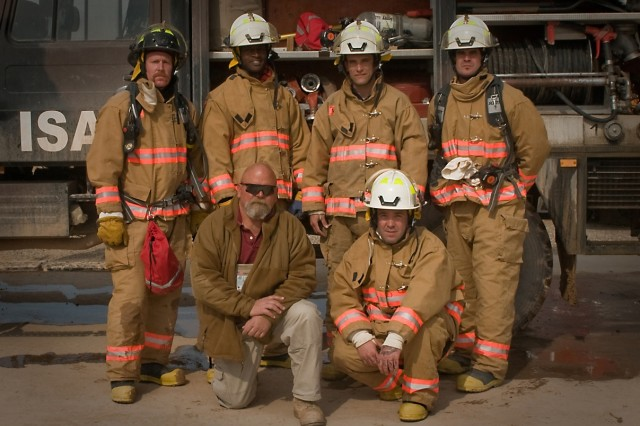 (From back left to front right) Firefighters John Krandall, a Kennedy, Ny., native; Edmund Hodo, a Nixa, Mo., native; Avery Hanoumis, a Riverside, Ca., native; Michael Muston, an Austin, Texas, native; George J. Chambers III, a Hillsboro, Tenn., Native; and William Woods, a Riverside Ca., native, pose in front of their truck Feb. 19 at Multi-National Base Tarin Kot, Afghanistan. The firefighters are all part of the Tarin Kot Fire Department that provides fire protection for soldiers from every nation on the base. Their assignment in Afghanistan is for one year, at which point they will be relieved by other U.S. firefighters. (U.S. Army photo by Spc. Edward A. Garibay, 16th Mobile Public Affairs Detachment)